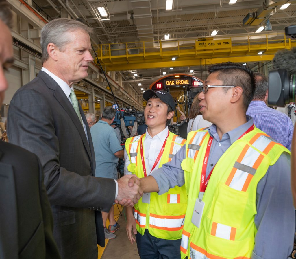 Govenor Baker shaking hands with CRRC employees